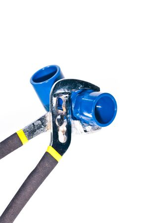 Adjustable wrench holding a pipe fixture photo