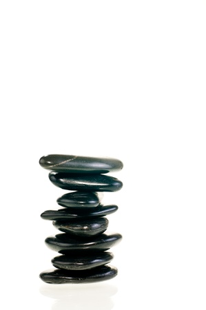 A stack of balanced zen stones isolated on white background Stock Photo - 11374229
