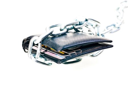Chained black wallet indicating stop spending money photo