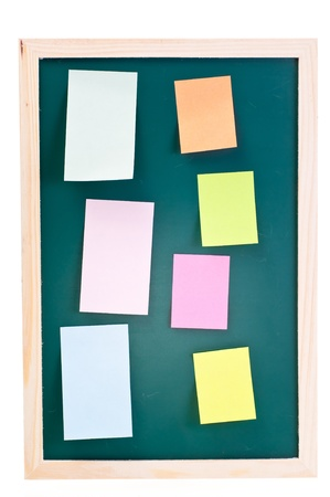 Green chalk board with colorful sticky notes photo