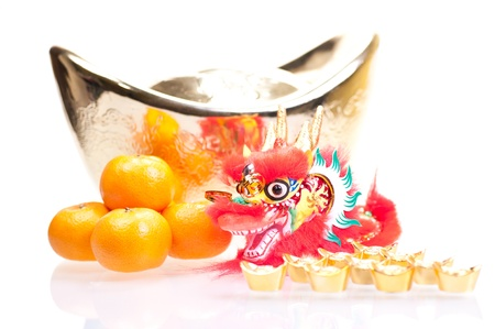 chinese new year dragon: Chinese new year with dragon decoration, large gold ingot and mandarin oranges Stock Photo