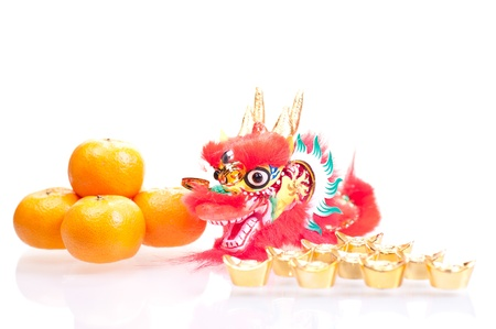 Chinese new year with dragon decoration, gold ingots and mandarin oranges