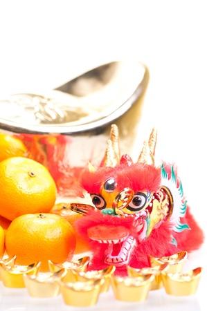 Chinese new year with dragon decoration, large gold ingot and mandarin oranges Stock Photo - 11374293
