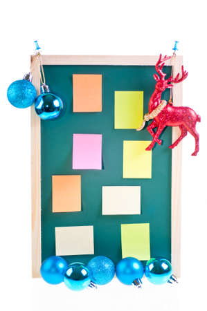 Christmas notice board with Christmas blue baubles, ornament and sticky notes on the board Stock Photo