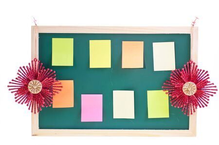 Christmas notice board with Christmas ornaments and sticky notes on the board photo