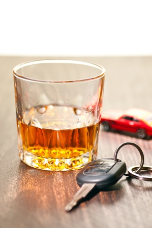 Whiskey neat with a car key indicating don