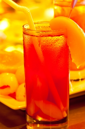 Ice peach tea with peaches at the background photo