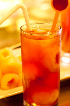Ice lychee tea and lychee at the background  photo