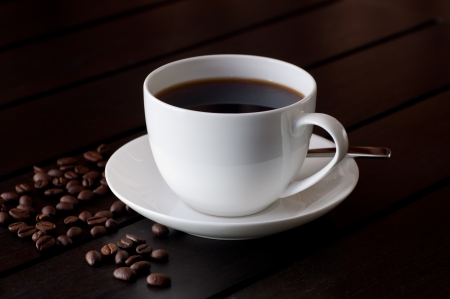 Black coffee on a wooden table photo