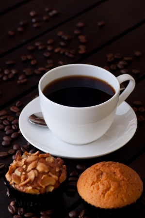 Coffee with two muffin on wooden table Stock Photo - 14619820