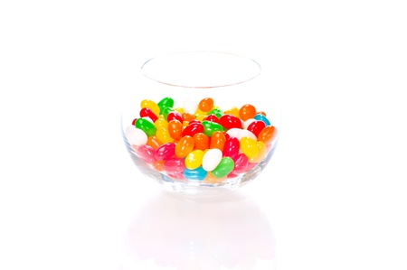 Colourful jelly beans in a glass bowl isolated on white background Stock Photo - 14619030