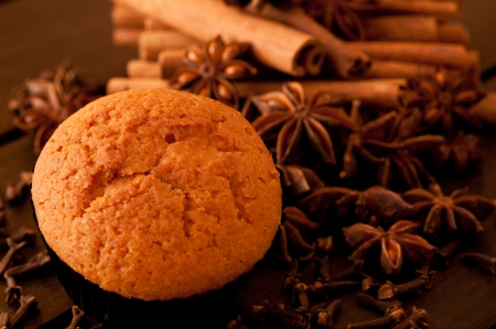 Muffin close up with spices background photo