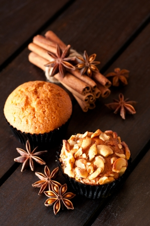 Vanilla and cashew nut muffin and spices close up