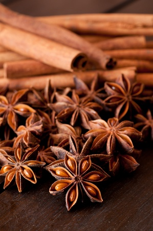 Star anise and cinnamon close up on wooden table photo