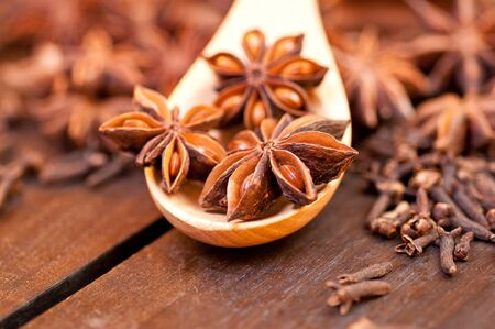 Star anise extreme close up with spices at background photo