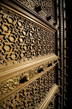 Old brass door in Jaipur India close up photo