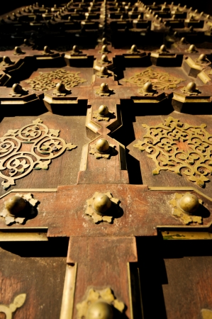 Old wood and brass door in Jaipur India close up photo