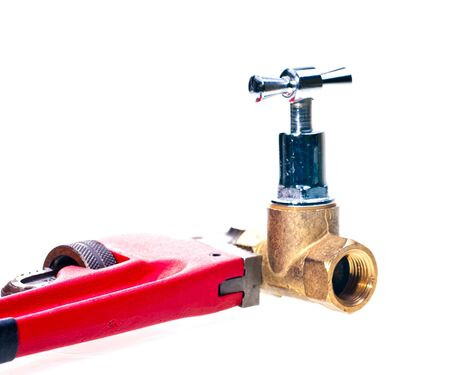 Pipe wrench holding brass tap pipe fittings Stock Photo - 15266090