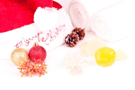 Christmas holiday spa concept with soaps, bath salts and towel photo