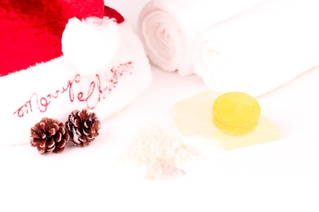 Christmas holiday spa concept with soaps,bath salt in a shape of a tree photo