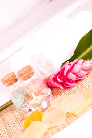 Holiday spa concept with pink ginger flower, soaps and bath salts  photo