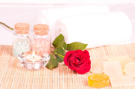 In room romantic spa concept with rose and bath salt photo