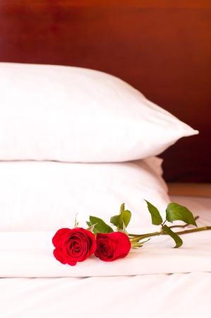 Romantic setting on a bed with red roses
