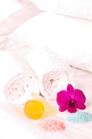 Spa concept orchids, bath soap and bath salt on a hotel bed  photo