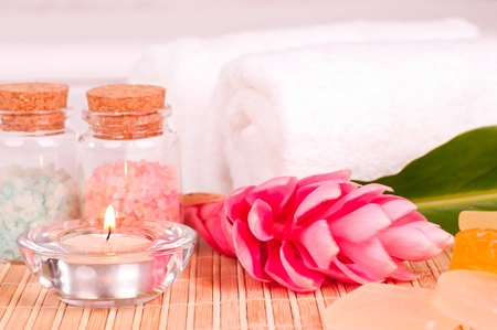 Spa holiday with a pink ginger flower in a hotel room photo