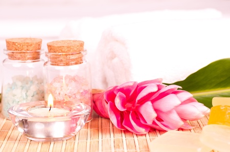 tealight: Spa holiday with a pink ginger flower, bath salts and tealight Stock Photo