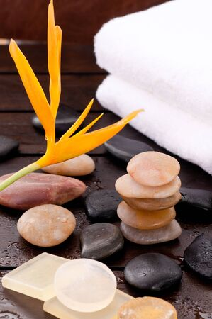 Spa garden with zen stones on a wooden table under the warm sun  photo