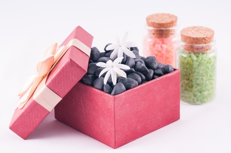Spa concept - a gift of wellness with black zen stones Stock Photo - 16960845