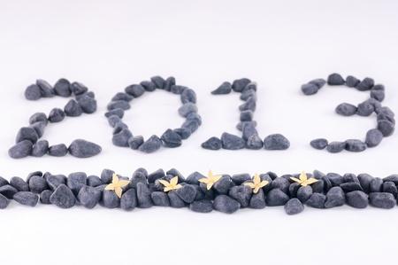 Jahr 2013 in Zen-Steine ??und gelb ixora Blumen close up