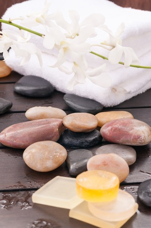 Spa concept with orchids, zen stones and soaps close up photo