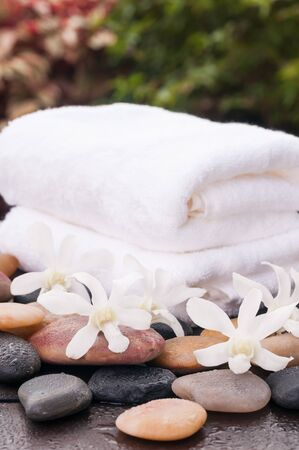 Outdoor spa concept with white orchids and zen stones  photo