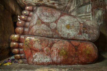 Reclining Buddha feet close up in Dambulla Cave Temple, Sri Lanka