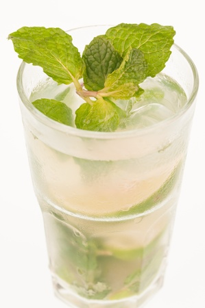 Mojito close up, a Cuban cocktail made with cuban rum, lime, sugar and a splash of soda photo