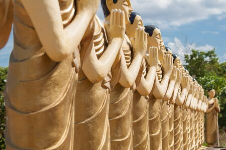 Buddhist monk statues close up in a Buddhist Temple in Sri Lanka photo