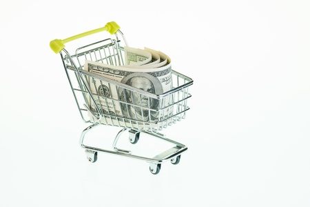inflation basket: American one hundred dollar bills in shopping cart over white background