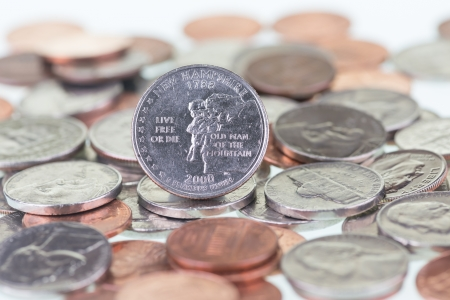 pluribus: New Hampshire State Quarter extreme close up with coins background