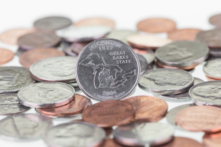 unum: Michigan State Quarter with coins extreme close up Stock Photo
