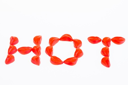 hot lips: HOT red lip gummy candies over white background
