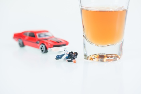 Drinking and driving concept with a motor vehicle collision and glass of whiskey Stock Photo