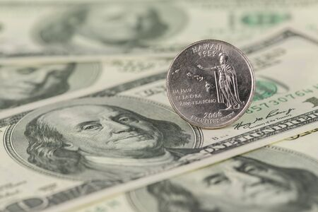 unum: 2008 Hawaii State Quarter on one hundred dollar bills background