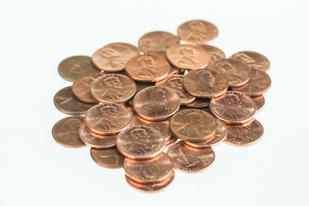 US pennies piled up over white background  Stock Photo