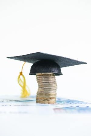 20 euro: Saving for higher education with Mortarboard on a stack of Euro coins and 20 Euro banknotes  Stock Photo