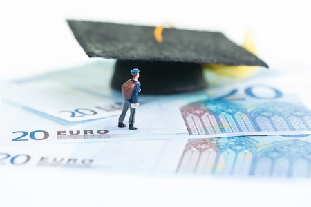 20 euro: Miniature man standing on top of 20 Euro banknotes and Mortarboard