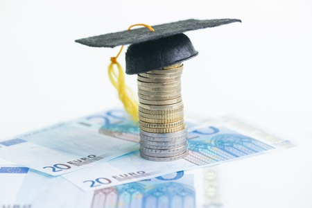 20 euro: Education savings with Mortarboard on top of coins and 20 Euro banknotes  Stock Photo