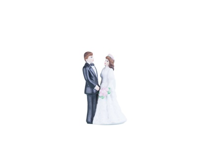 Procelain bride and groom over white background photo