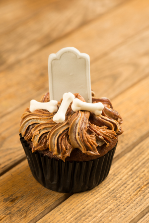 Halloween cupcake on an old rustic wood background  photo